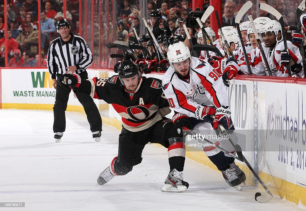 <a gi-track='captionPersonalityLinkClicked' href=/galleries/search?phrase=Erik+Karlsson&family=editorial&specificpeople=5370939 ng-click='$event.stopPropagation()'>Erik Karlsson</a> #65 of the Ottawa Senators battles for the puck against <a gi-track='captionPersonalityLinkClicked' href=/galleries/search?phrase=Marcus+Johansson&family=editorial&specificpeople=4247883 ng-click='$event.stopPropagation()'>Marcus Johansson</a> #90 of the Washington Capitals during an NHL game at Canadian Tire Centre on December 30, 2013 in Ottawa, Ontario, Canada.