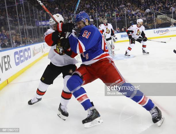 Erik Karlsson of the Ottawa Senators battles with Rick Nash of the New York Rangers in Game Six of the Eastern Conference Second Round during the...