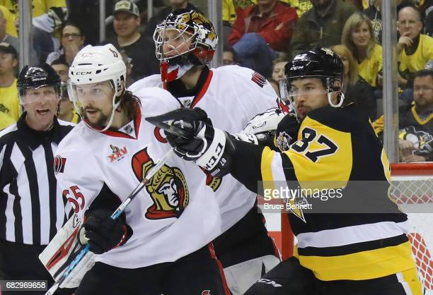 Erik Karlsson of the Ottawa Senators battles with Sidney Crosby of the Pittsburgh Penguins in Game One of the Eastern Conference Final during the...
