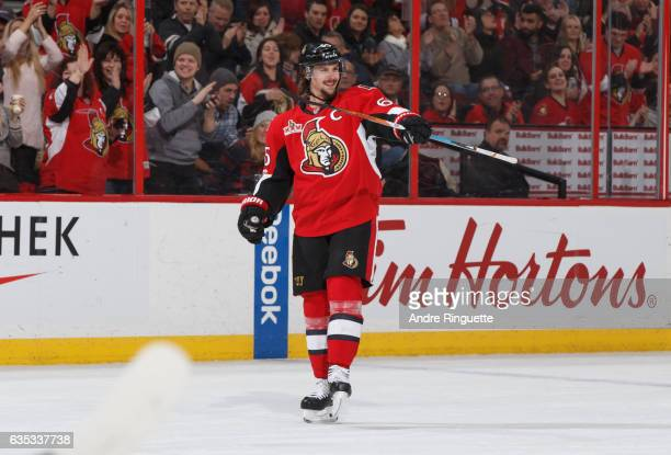 Erik Karlsson of the Ottawa Senators celebrates a first period goal by teammate Bobby Ryan against the Buffalo Sabres at Canadian Tire Centre on...
