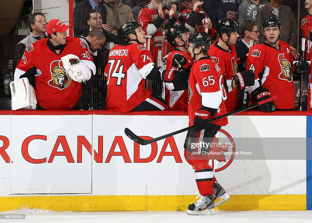 Erik Karlsson #65 of the Ottawa Senators celebrates his first period goal with teammates Ben Bishop #30 and Mark Borowiecki #74 during an NHL game against the Buffalo Sabres at Scotiabank Place on February 5, 2013 in Ottawa, Ontario, Canada.