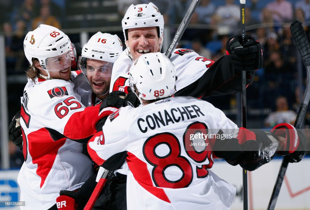 Erik Karlsson #65 of the Ottawa Senators celebrates his game winning third period goal against the Buffalo Sabres with teammates Clarke MacArthur #16, Marc Methot #3 and Cory Conacher #89 at First Niagara Center on October 4, 2013 in Buffalo, New York. Ottawa defeated Buffalo 1-0.