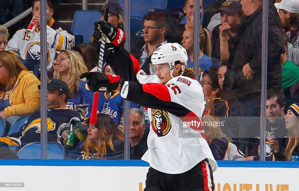 Erik Karlsson #65 of the Ottawa Senators celebrates his game-winning goal against the Buffalo Sabres on October 4, 2013 at the First Niagara Center in Buffalo, New York. Ottawa defeated Buffalo, 1-0.