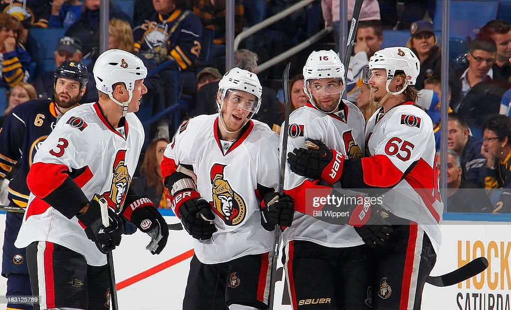 <a gi-track='captionPersonalityLinkClicked' href=/galleries/search?phrase=Erik+Karlsson&family=editorial&specificpeople=5370939 ng-click='$event.stopPropagation()'>Erik Karlsson</a> #65 of the Ottawa Senators celebrates his game-winning goal with teammates <a gi-track='captionPersonalityLinkClicked' href=/galleries/search?phrase=Marc+Methot&family=editorial&specificpeople=2216900 ng-click='$event.stopPropagation()'>Marc Methot</a> #3, <a gi-track='captionPersonalityLinkClicked' href=/galleries/search?phrase=Kyle+Turris&family=editorial&specificpeople=4251834 ng-click='$event.stopPropagation()'>Kyle Turris</a> #7 and <a gi-track='captionPersonalityLinkClicked' href=/galleries/search?phrase=Clarke+MacArthur&family=editorial&specificpeople=3949382 ng-click='$event.stopPropagation()'>Clarke MacArthur</a> #16 against the Buffalo Sabres on October 4, 2013 at the First Niagara Center in Buffalo, New York. Ottawa defeated Buffalo, 1-0.