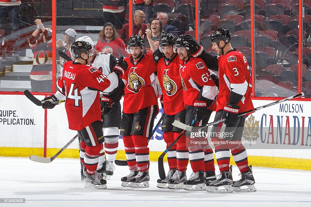 Erik Karlsson #65 of the Ottawa Senators celebrates his open net goal with teammates Jean-Gabriel Pageau #44, Tom Pyatt #10, Chris Kelly #22 and Marc Methot #3 in an NHL game against the Arizona Coyotes at Canadian Tire Centre on October 18, 2016 in Ottawa, Ontario, Canada.