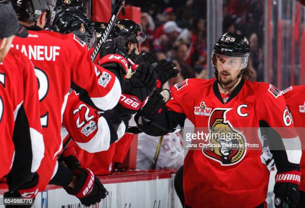 Erik Karlsson of the Ottawa Senators celebrates his third period goal against the Montreal Canadiens with team mates on the bench at Canadian Tire...