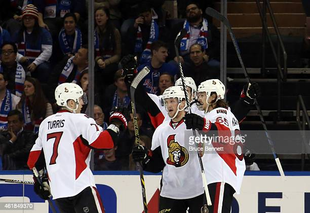 Erik Karlsson of the Ottawa Senators celebrates with his teammates after scoring a goal in the second period againsy Henrik Lundqvist of the New York...