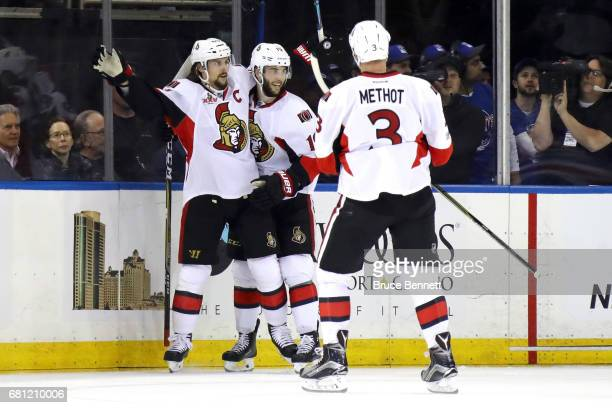 Erik Karlsson of the Ottawa Senators celebrates with teammates Derick Brassard and Marc Methot after scoring a goal against Henrik Lundqvist of the...