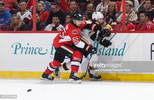 Erik Karlsson of the Ottawa Senators checks Brad Marchand of the Boston Bruins off the puck in the first period in Game Five of the Eastern...