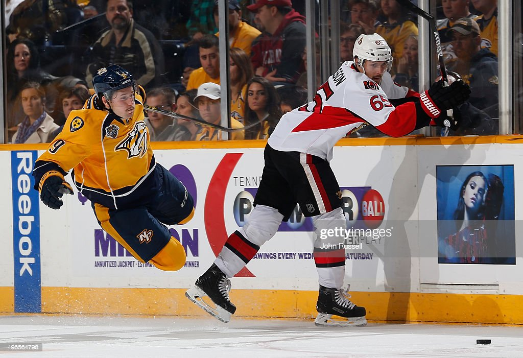 <a gi-track='captionPersonalityLinkClicked' href=/galleries/search?phrase=Erik+Karlsson&family=editorial&specificpeople=5370939 ng-click='$event.stopPropagation()'>Erik Karlsson</a> #65 of the Ottawa Senators checks <a gi-track='captionPersonalityLinkClicked' href=/galleries/search?phrase=Filip+Forsberg&family=editorial&specificpeople=8768623 ng-click='$event.stopPropagation()'>Filip Forsberg</a> #9 of the Nashville Predators off the puck during an NHL game at Bridgestone Arena on November 10, 2015 in Nashville, Tennessee.