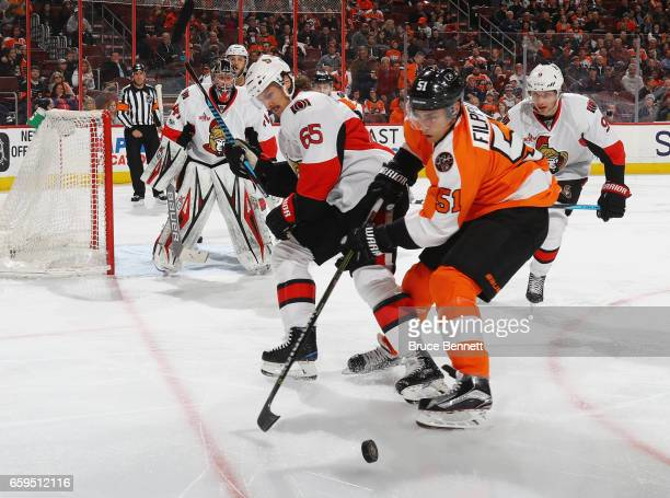 Erik Karlsson of the Ottawa Senators checks Valtteri Filppula of the Philadelphia Flyers during the second period at the Wells Fargo Center on March...