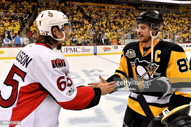 Erik Karlsson of the Ottawa Senators congratulates Sidney Crosby of the Pittsburgh Penguins after winning Game Seven of the Eastern Conference Final...