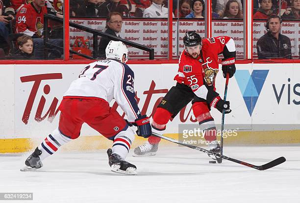 Erik Karlsson of the Ottawa Senators controls the puck against Ryan Murray of the Columbus Blue Jackets at Canadian Tire Centre on January 22 2017 in...