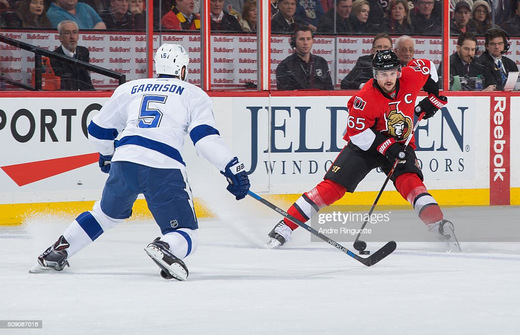 <a gi-track='captionPersonalityLinkClicked' href=/galleries/search?phrase=Erik+Karlsson&family=editorial&specificpeople=5370939 ng-click='$event.stopPropagation()'>Erik Karlsson</a> #65 of the Ottawa Senators controls the puck at the blue line against <a gi-track='captionPersonalityLinkClicked' href=/galleries/search?phrase=Jason+Garrison&family=editorial&specificpeople=2143635 ng-click='$event.stopPropagation()'>Jason Garrison</a> #5 of the Tampa Bay Lightning at Canadian Tire Centre on February 8, 2016 in Ottawa, Ontario, Canada.
