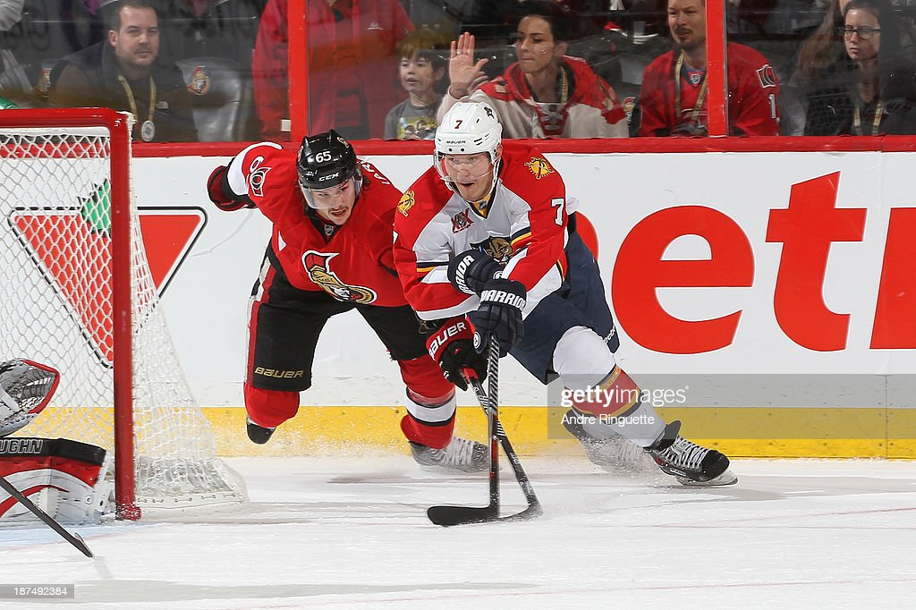 <a gi-track='captionPersonalityLinkClicked' href=/galleries/search?phrase=Erik+Karlsson&family=editorial&specificpeople=5370939 ng-click='$event.stopPropagation()'>Erik Karlsson</a> #65 of the Ottawa Senators defends against a last-second wrap-around attempt by Dmitry Kulikov #7 of the Florida Panthers at Canadian Tire Centre on November 9, 2013 in Ottawa, Ontario, Canada.