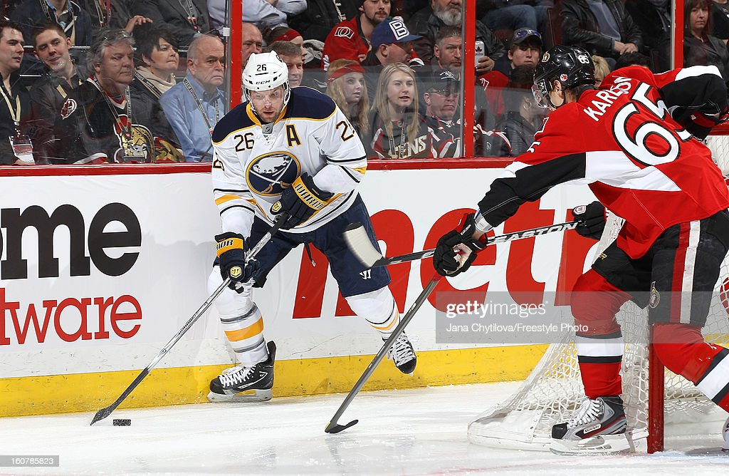 Erik Karlsson #65 of the Ottawa Senators defends against a puck carrying Thomas Vanek #26 of the Buffalo Sabres during an NHL game at Scotiabank Place on February 5, 2013 in Ottawa, Ontario, Canada.
