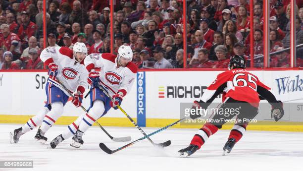 Erik Karlsson of the Ottawa Senators defends against Alexander Radulov and Alex Galchenyuk of the Montreal Canadiens in the third period at Canadian...
