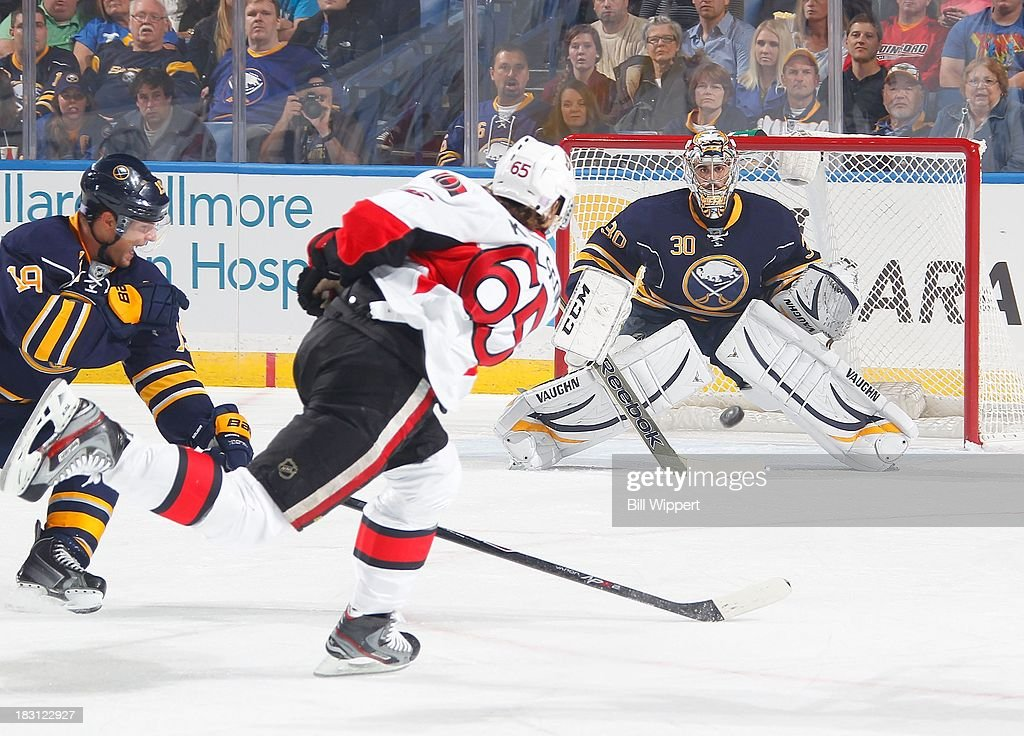 Erik Karlsson #65 of the Ottawa Senators fires a first period slapshot against Ryan Miller #30 of the Buffalo Sabres on October 4, 2013 at the First Niagara Center in Buffalo, New York.
