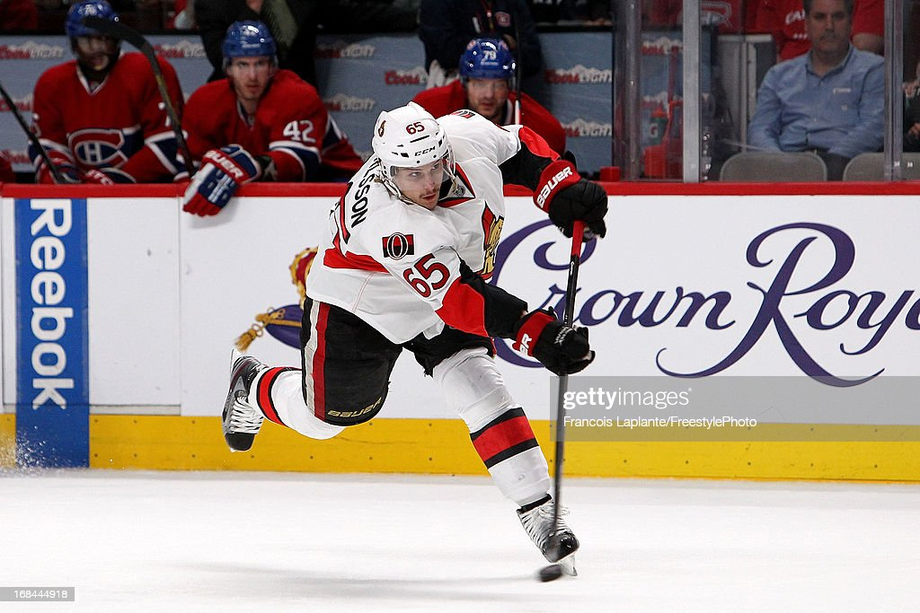 <a gi-track='captionPersonalityLinkClicked' href=/galleries/search?phrase=Erik+Karlsson&family=editorial&specificpeople=5370939 ng-click='$event.stopPropagation()'>Erik Karlsson</a> #65 of the Ottawa Senators fires a slapshot against the Montreal Canadiens in Game Five of the Eastern Conference Quarterfinals during the 2013 NHL Stanley Cup Playoffs at the Bell Centre on May 9, 2013 in Montreal, Quebec, Canada.