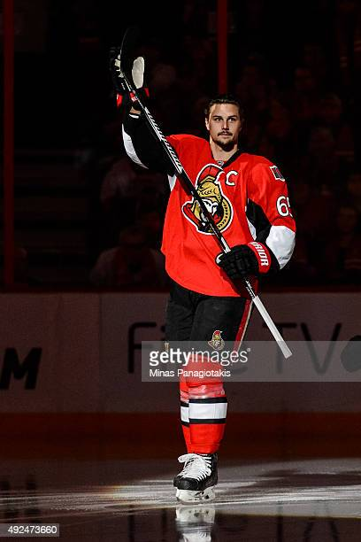Erik Karlsson of the Ottawa Senators greets fans as he takes to the ice in the pre game ceremony during the NHL match against the Montreal Canadiens...