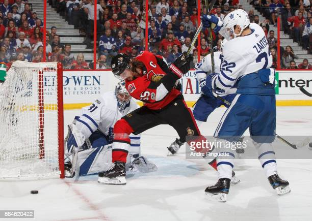 Erik Karlsson of the Ottawa Senators is stopped on a scoring chance by Frederik Andersen and Nikita Zaitsev of the Toronto Maple Leafs at Canadian...