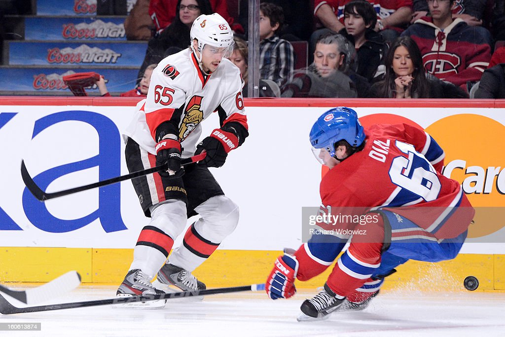 <a gi-track='captionPersonalityLinkClicked' href=/galleries/search?phrase=Erik+Karlsson&family=editorial&specificpeople=5370939 ng-click='$event.stopPropagation()'>Erik Karlsson</a> #65 of the Ottawa Senators passes the puck in front of <a gi-track='captionPersonalityLinkClicked' href=/galleries/search?phrase=Raphael+Diaz&family=editorial&specificpeople=5333791 ng-click='$event.stopPropagation()'>Raphael Diaz</a> #61 of the Montreal Canadiens during the NHL game at the Bell Centre on February 3, 2013 in Montreal, Quebec, Canada. The Canadiens defeated the Senators 2-1.
