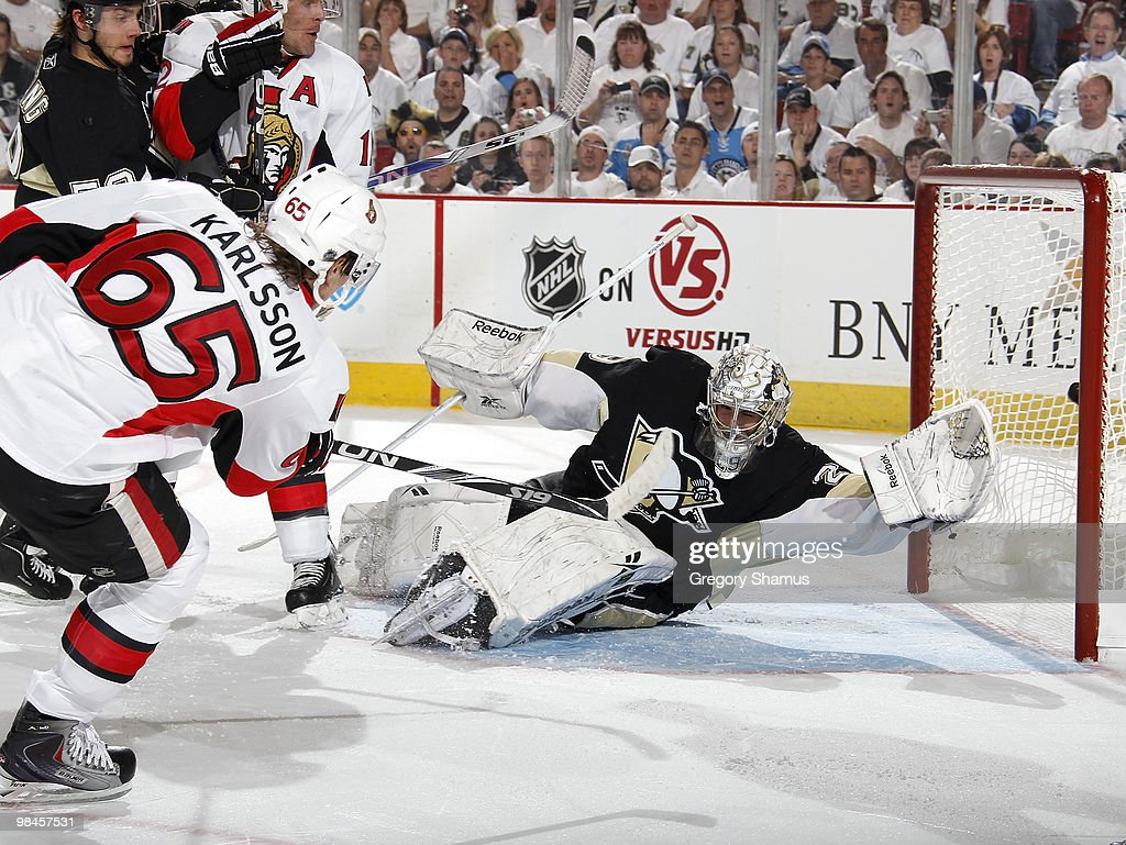 Erik Karlsson of the Ottawa Senators scores on MarcAndre Fleury of the Pittsburgh Penguins in Game One of the Eastern Conference Quaterfinals during...