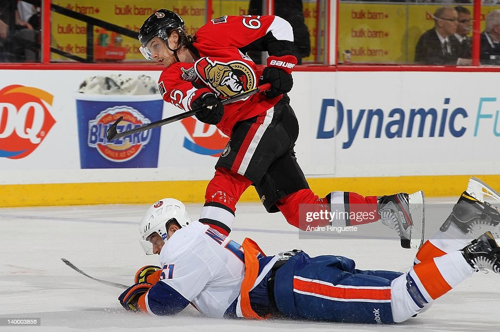 <a gi-track='captionPersonalityLinkClicked' href=/galleries/search?phrase=Erik+Karlsson&family=editorial&specificpeople=5370939 ng-click='$event.stopPropagation()'>Erik Karlsson</a> #65 of the Ottawa Senators shoots the puck as <a gi-track='captionPersonalityLinkClicked' href=/galleries/search?phrase=Frans+Nielsen&family=editorial&specificpeople=634894 ng-click='$event.stopPropagation()'>Frans Nielsen</a> #51 of the New York Islanders dives to block the shot at Scotiabank Place on February 26, 2012 in Ottawa, Ontario, Canada.