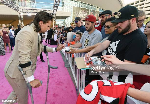 Erik Karlsson of the Ottawa Senators signs autographs as he attends the 2017 NHL Awards at TMobile Arena on June 21 2017 in Las Vegas Nevada