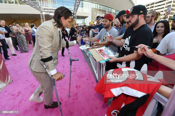 Erik Karlsson of the Ottawa Senators signs autographs for fans at the 2017 NHL Awards at TMobile Arena on June 21 2017 in Las Vegas Nevada