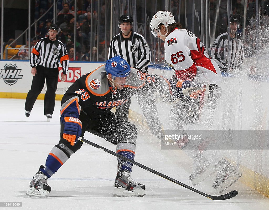 <a gi-track='captionPersonalityLinkClicked' href=/galleries/search?phrase=Erik+Karlsson&family=editorial&specificpeople=5370939 ng-click='$event.stopPropagation()'>Erik Karlsson</a> #65 of the Ottawa Senators skates against <a gi-track='captionPersonalityLinkClicked' href=/galleries/search?phrase=Jay+Pandolfo&family=editorial&specificpeople=202871 ng-click='$event.stopPropagation()'>Jay Pandolfo</a> #29 of the New York Islanders at Nassau Veterans Memorial Coliseum on February 20, 2012 in Uniondale, New York. The Senators defeated the Islanders 6-0.