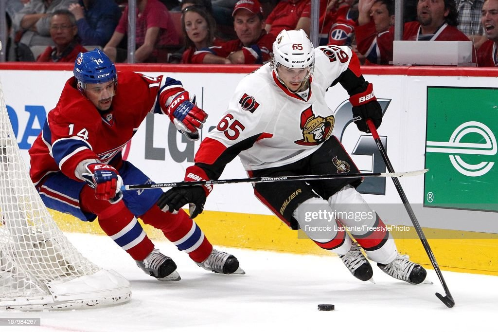 <a gi-track='captionPersonalityLinkClicked' href=/galleries/search?phrase=Erik+Karlsson&family=editorial&specificpeople=5370939 ng-click='$event.stopPropagation()'>Erik Karlsson</a> #65 of the Ottawa Senators skates with the puck against <a gi-track='captionPersonalityLinkClicked' href=/galleries/search?phrase=Tomas+Plekanec&family=editorial&specificpeople=620244 ng-click='$event.stopPropagation()'>Tomas Plekanec</a> #14 of the Montreal Canadiens in Game Two of the Eastern Conference Quarterfinals during the 2013 NHL Stanley Cup Playoffs at the Bell Centre on May 3, 2013 in Montreal, Quebec, Canada.