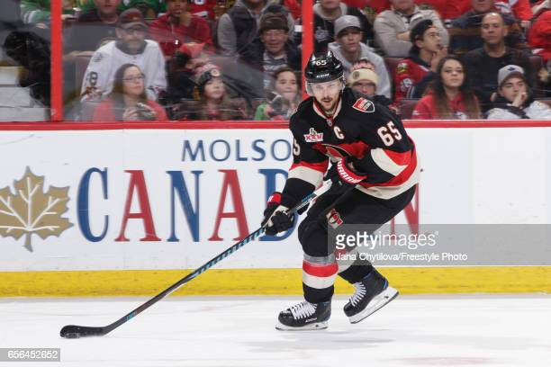 Erik Karlsson of the Ottawa Senators skates with the puck against the Chicago Blackhawks at Canadian Tire Centre on March 16 2017 in Ottawa Ontario...