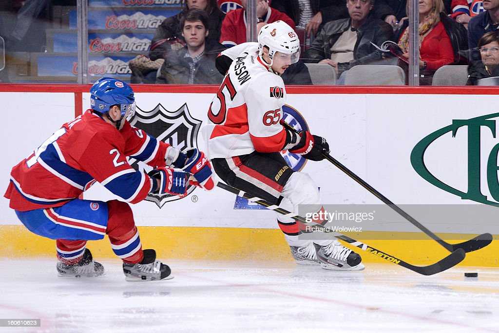 <a gi-track='captionPersonalityLinkClicked' href=/galleries/search?phrase=Erik+Karlsson&family=editorial&specificpeople=5370939 ng-click='$event.stopPropagation()'>Erik Karlsson</a> #65 of the Ottawa Senators skates with the puck while being chased by <a gi-track='captionPersonalityLinkClicked' href=/galleries/search?phrase=Brian+Gionta&family=editorial&specificpeople=202116 ng-click='$event.stopPropagation()'>Brian Gionta</a> #21 of the Montreal Canadiens during the NHL game at the Bell Centre on February 3, 2013 in Montreal, Quebec, Canada. The Canadiens defeated the Senators 2-1.