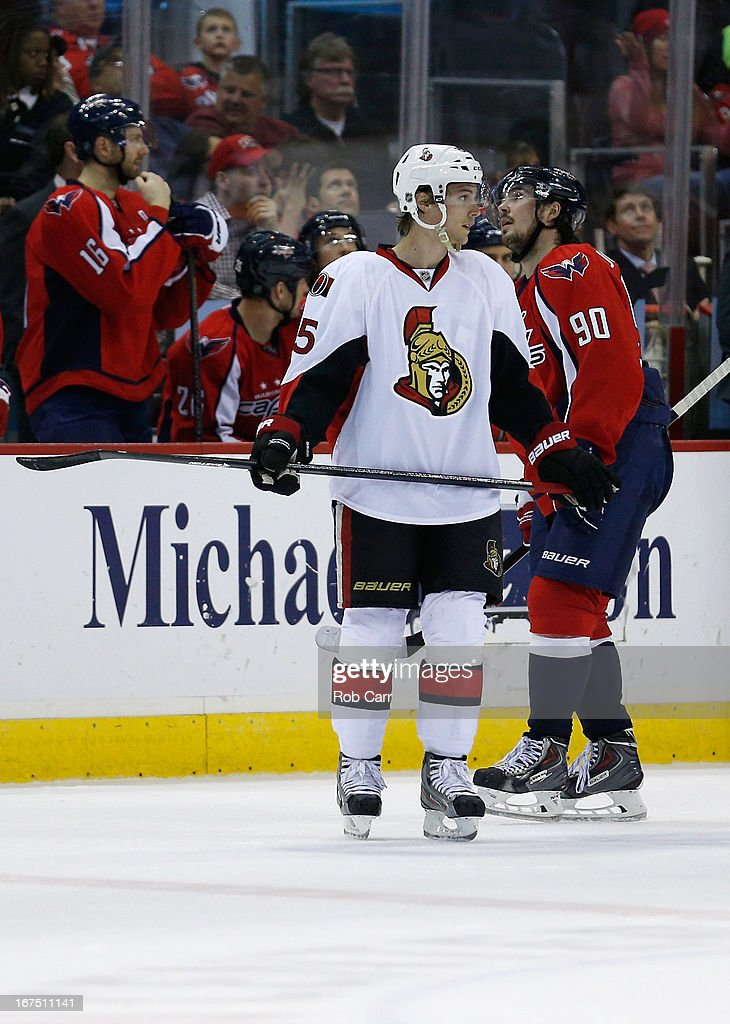 <a gi-track='captionPersonalityLinkClicked' href=/galleries/search?phrase=Erik+Karlsson&family=editorial&specificpeople=5370939 ng-click='$event.stopPropagation()'>Erik Karlsson</a> #65 of the Ottawa Senators stakes in front of <a gi-track='captionPersonalityLinkClicked' href=/galleries/search?phrase=Marcus+Johansson&family=editorial&specificpeople=4247883 ng-click='$event.stopPropagation()'>Marcus Johansson</a> #90 of the Washington Capitals during the third period of the Senators 2-1 overtime win at Verizon Center on April 25, 2013 in Washington, DC.