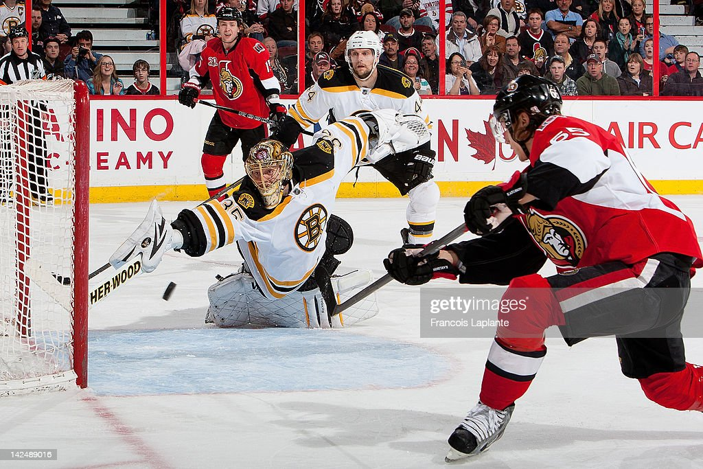 <a gi-track='captionPersonalityLinkClicked' href=/galleries/search?phrase=Erik+Karlsson&family=editorial&specificpeople=5370939 ng-click='$event.stopPropagation()'>Erik Karlsson</a> #65 of the Ottawa Senators takes a shoot wide of the net as <a gi-track='captionPersonalityLinkClicked' href=/galleries/search?phrase=Anton+Khudobin&family=editorial&specificpeople=722106 ng-click='$event.stopPropagation()'>Anton Khudobin</a> #35 the Boston Bruins guards his net at Scotiabank Place on April 5, 2012 in Ottawa, Ontario, Canada.