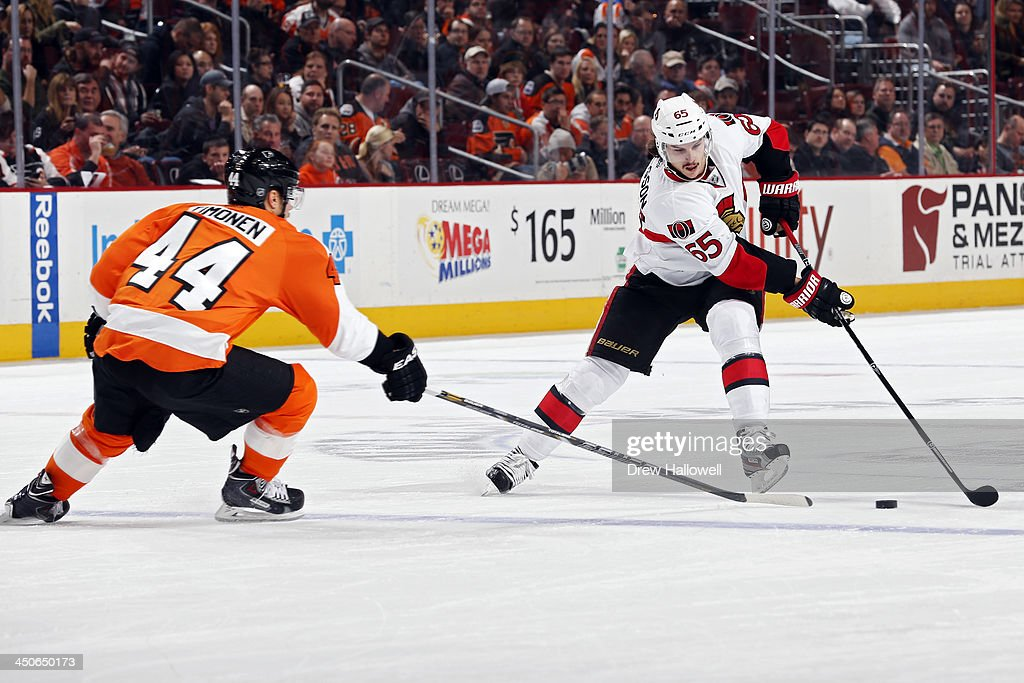 Erik Karlsson #65 of the Ottawa Senators tries to skate the puck past Kimmo Timonen #44 of the Philadelphia Flyers at the Wells Fargo Center on November 19, 2013 in Philadelphia, Pennsylvania.