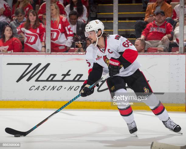 Erik Karlsson of the Ottawa Senators turns up ice with the puck against the Detroit Red Wings during an NHL game at Joe Louis Arena on April 3 2017...
