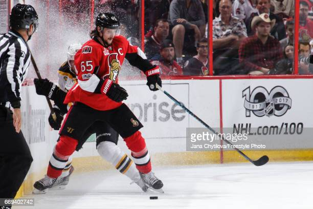 Erik Karlsson of the Ottawa Senators uses his body to keep the puck from Joe Morrow of the Boston Bruins in Game Two of the Eastern Conference First...
