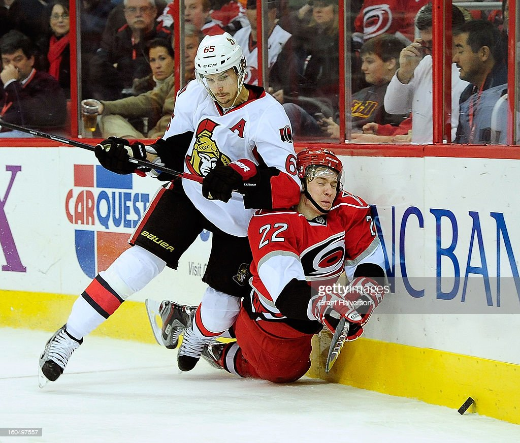 Erik Karlsson #65 of the Ottowa Senators draws a two minute penalty for elbowing Zac Dalpe #22 of the Carolina Hurricanes during the second period at PNC Arena on February 1, 2013 in Raleigh, North Carolina.
