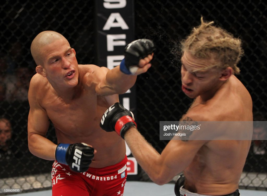 Erik Koch punches Jonathan Brookins during the UFC Fight Night event at the New Orleans Convention Center on September 17, 2011 in New Orleans, Louisiana.