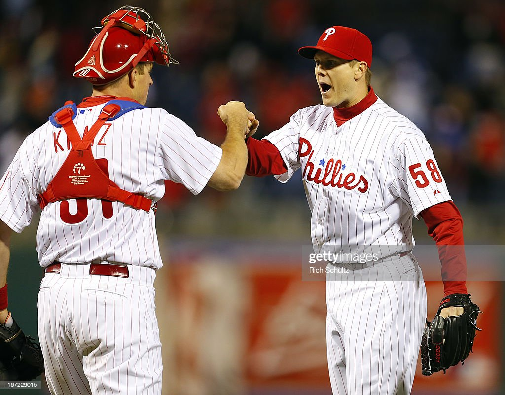 Erik Kratz #31 congratulates teammate <a gi-track='captionPersonalityLinkClicked' href=/galleries/search?phrase=Jonathan+Papelbon&family=editorial&specificpeople=453535 ng-click='$event.stopPropagation()'>Jonathan Papelbon</a> #58 of the Philadelphia Phillies Papelbon struck out Pedro Alvarez #24 of the Pittsburgh Pirates ending the game as the Phillies defeated the Pirates 3-2 with Papelbon getting the save on April 22, 2013 at Citizens Bank Park in Philadelphia, Pennsylvania.