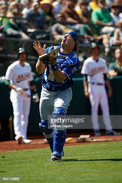 Erik Kratz of the Kansas City Royals chases a popup during the game against the Oakland Athletics at Oco Coliseum on August 2 2014 in Oakland...