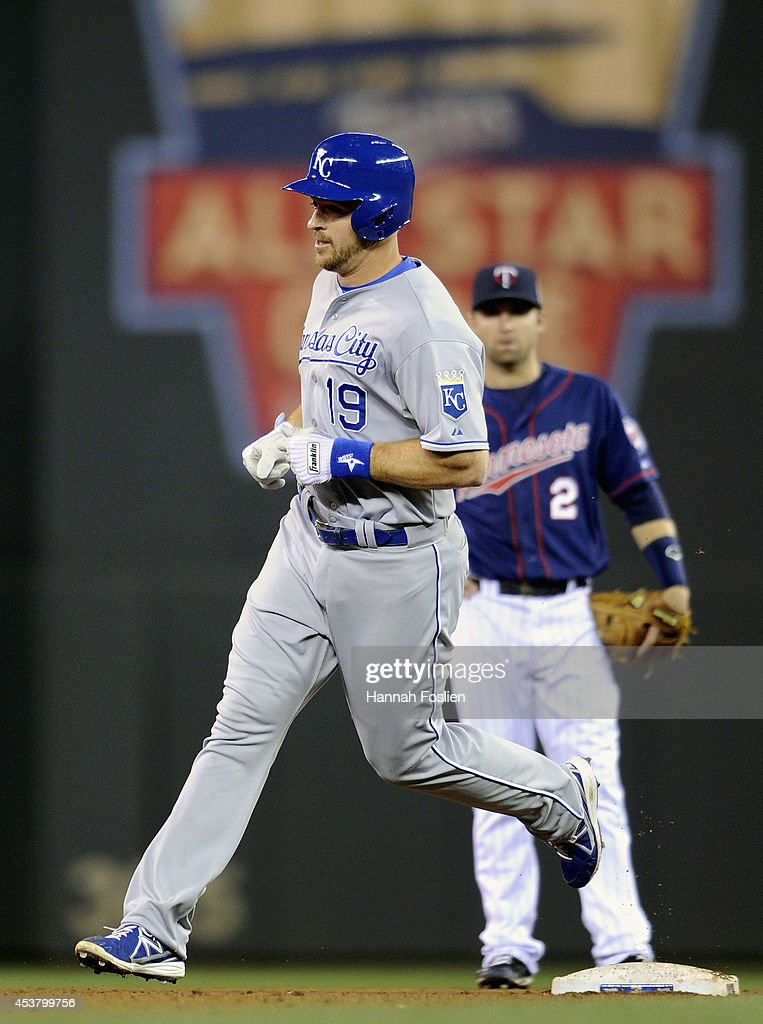 Erik Kratz of the Kansas City Royals rounds the bases after hitting a solo home run as Brian Dozier of the Minnesota Twins looks on during the...