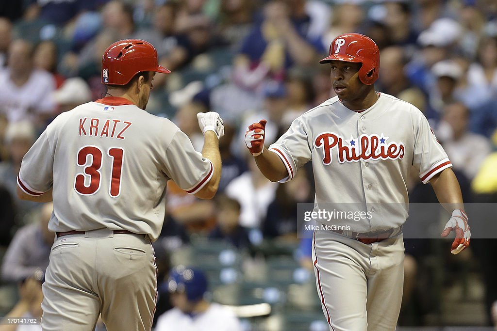 <a gi-track='captionPersonalityLinkClicked' href=/galleries/search?phrase=Erik+Kratz&family=editorial&specificpeople=809194 ng-click='$event.stopPropagation()'>Erik Kratz</a> #31 of the Philadelphia Phillies celebrates with <a gi-track='captionPersonalityLinkClicked' href=/galleries/search?phrase=Delmon+Young&family=editorial&specificpeople=700362 ng-click='$event.stopPropagation()'>Delmon Young</a> #3 after hitting a two run homer in the top of the fourth inning against the Milwaukee Brewers during the game at Miller Park on June 07, 2013 in Milwaukee, Wisconsin.