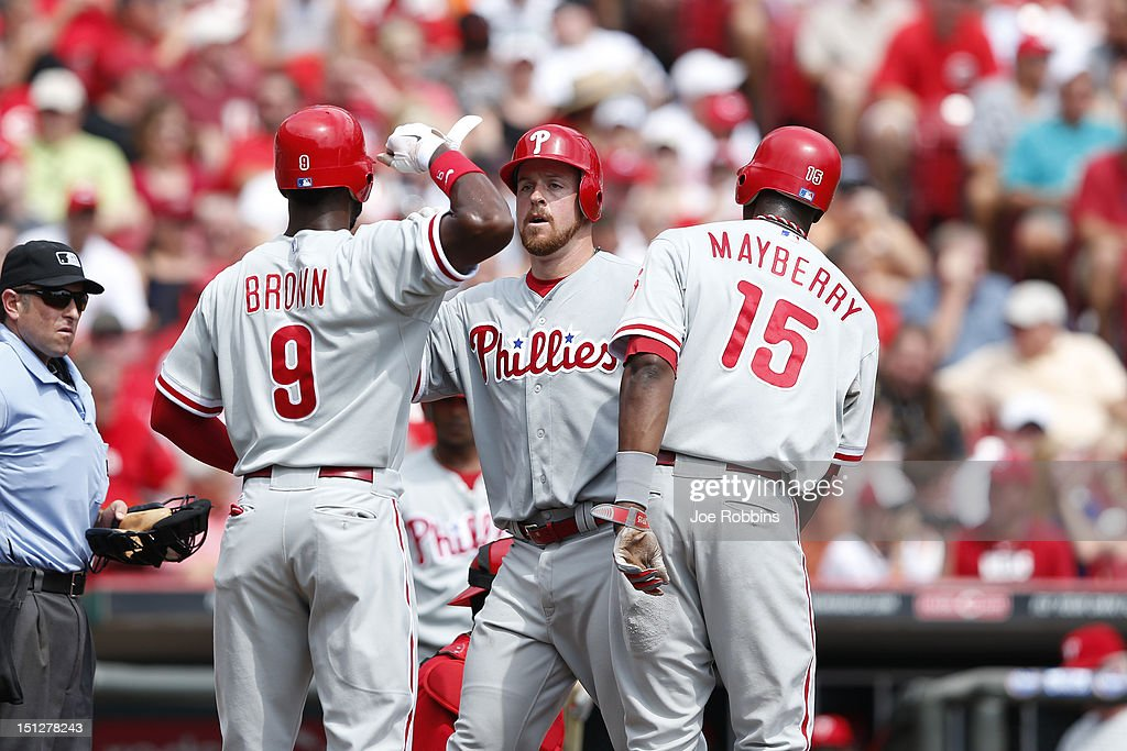 Erik Kratz #31 of the Philadelphia Phillies celebrates with Domonic Brown #9 and <a gi-track='captionPersonalityLinkClicked' href=/galleries/search?phrase=John+Mayberry+Jr.&family=editorial&specificpeople=4959058 ng-click='$event.stopPropagation()'>John Mayberry Jr.</a> #15 after hitting a three-run home run in the second inning of the game against the Cincinnati Reds at Great American Ball Park on September 5, 2012 in Cincinnati, Ohio.