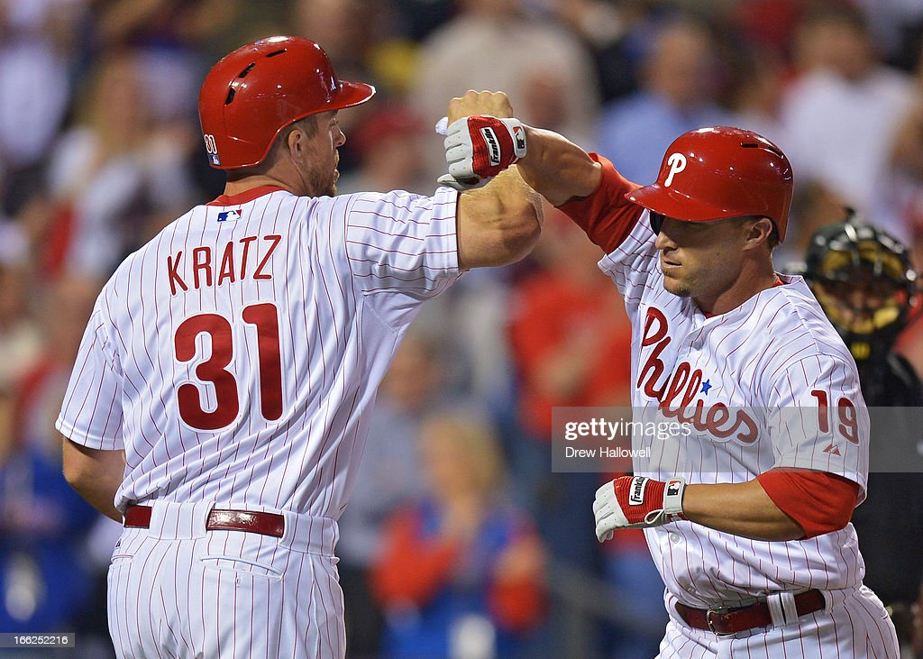 Erik Kratz #31 of the Philadelphia Phillies congratulates teammate <a gi-track='captionPersonalityLinkClicked' href=/galleries/search?phrase=Laynce+Nix&family=editorial&specificpeople=214636 ng-click='$event.stopPropagation()'>Laynce Nix</a> #19 on his two-run home run in the sixth inning during the game against the New York Mets at Citizens Bank Park on April 10, 2013 in Philadelphia, Pennsylvania. The Phillies won 7-3.