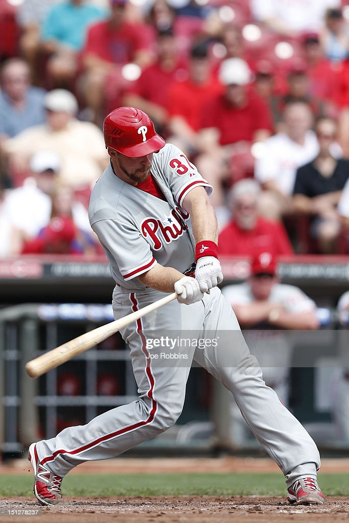 Erik Kratz #31 of the Philadelphia Phillies hits a three-run home run in the second inning of the game against the Cincinnati Reds at Great American Ball Park on September 5, 2012 in Cincinnati, Ohio.