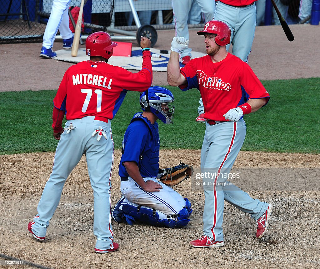 Erik Kratz #31 of the Philadelphia Phillies is congratulated by Jermaine Mitchell #71 after hitting a ninth inning home run during a spring training game against the Toronto Blue Jays at Florida Auto Exchange Stadium on March 2, 2013 in Dunedin, Florida.