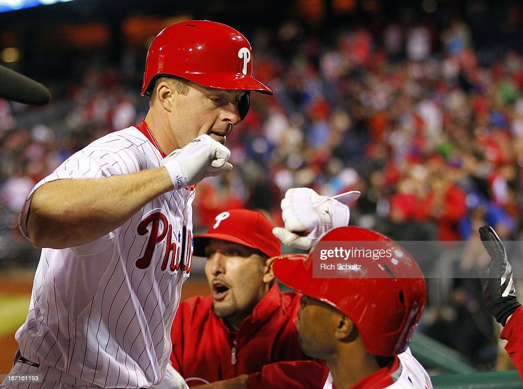 Erik Kratz #31 of the Philadelphia Phillies is congratulated by teammates after hitting a three run-home run in the eighth inning against of the St. Louis Cardinals in a MLB baseball game on April 21, 2013 at Citizens Bank Park in Philadelphia, Pennsylvania. The Phillies defeated the Cardinals 7-3.